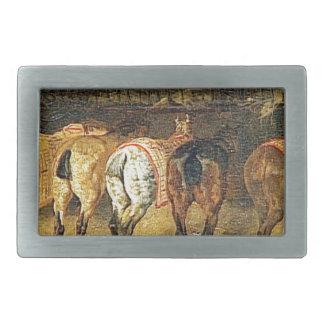 Cinco caballos vistos de detrás con los croupes hebillas cinturón rectangulares