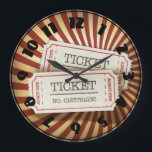 """Cinema Tickets Clock<br><div class=""""desc"""">Going to the cinema is always such fun. Nothing like it really. Of course tickets are needed and this design is perfect as it is all about cinema tickets. The design has two cinema tickets on a patterned background. They really pop. This cinema tickets design looks great on this clock....</div>"""