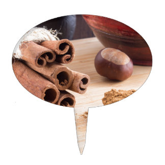 Cinnamon sticks and powder cake topper