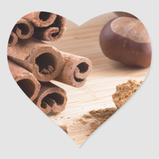 Cinnamon sticks and powder heart sticker