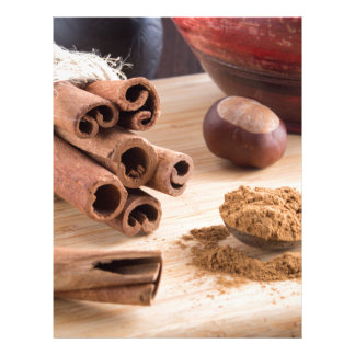Cinnamon sticks and powder letterhead