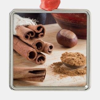 Cinnamon sticks and powder metal ornament