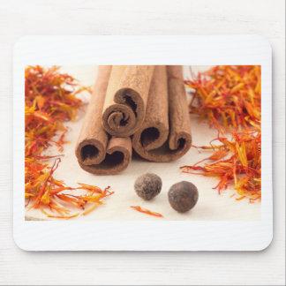 Cinnamon sticks, aromatic saffron and pimento mouse pad