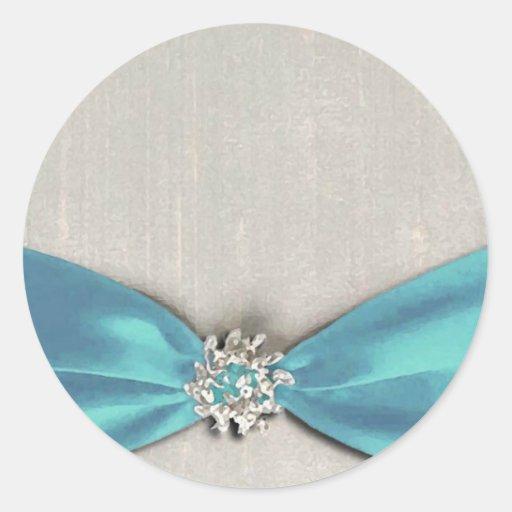 cinta de satén azul con la copia de la joya etiquetas redondas