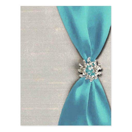 cinta de satén azul con la copia de la joya postales