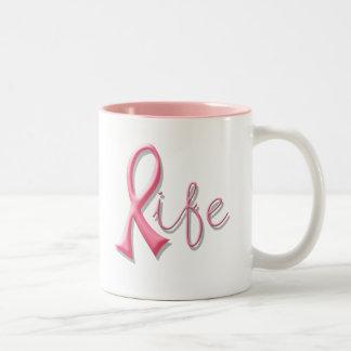 Cinta rosada de la vida taza de dos tonos