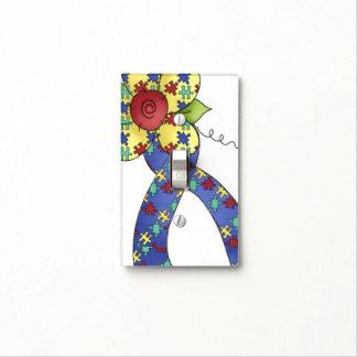 Cinta y flor de la conciencia del rompecabezas del placa para interruptor