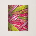 Cintas que fluyen de la hoja rosada rompecabeza con fotos