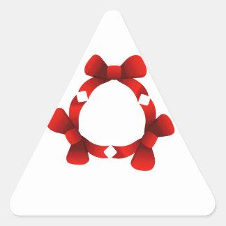 Cintas rojas en círculo pegatina triangular
