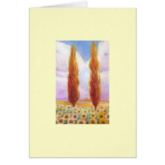 Cipreses rojos en campo del girasol tarjeta de felicitación