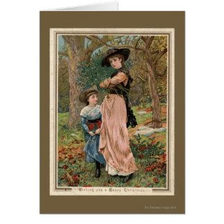 Circa 1870: Young girls collecting mistletoe Card