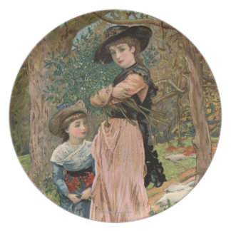 Circa 1870: Young girls collecting mistletoe Plate