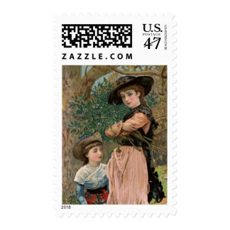 Circa 1870: Young girls collecting mistletoe Postage