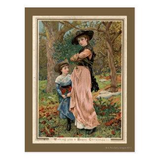 Circa 1870: Young girls collecting mistletoe Postcard
