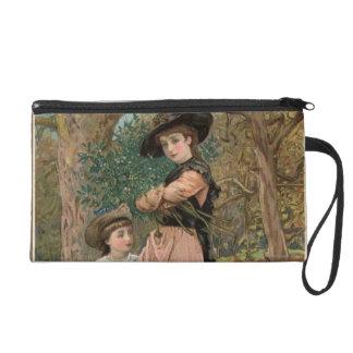 Circa 1870: Young girls collecting mistletoe Wristlet Purse