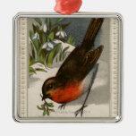 Circa 1871: A robin, with mistletoe in its beak Ornament