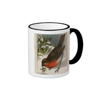 Circa 1871: A robin, with mistletoe in its beak Ringer Mug