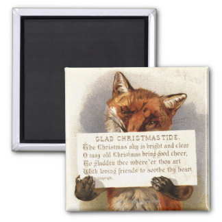 Circa 1900: A fox holds a Christmas verse Magnet