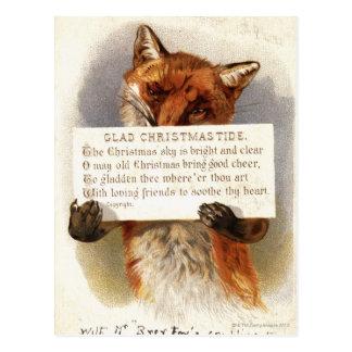 Circa 1900: A fox holds a Christmas verse Post Cards