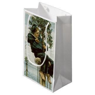 Circa 1900: A sailor ties holly to the masthead Small Gift Bag