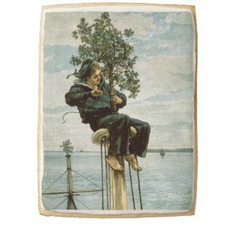 Circa 1900: A sailor ties holly to the masthead Jumbo Cookie