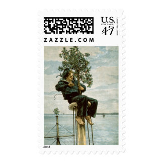 Circa 1900: A sailor ties holly to the masthead Stamp