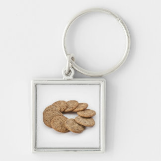 Circle of cookies on a white background keychain