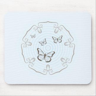Circular design and butterflies mouse pad