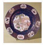 Circular dish with a musical scene posters