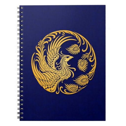 Círculo amarillo tradicional de Phoenix en azul Libretas Espirales