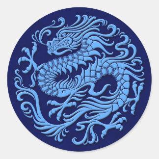 Círculo chino azul tradicional del dragón etiquetas redondas