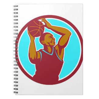 Círculo de la bola del jugador de básquet que libretas