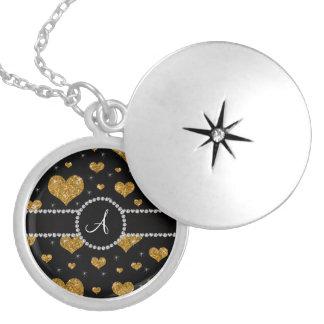 Círculo del diamante negro de los corazones del medallón