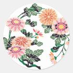 Círculo japonés de la flor pegatina redonda