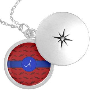 Círculo rojo del azul de los bigotes del monograma medallón