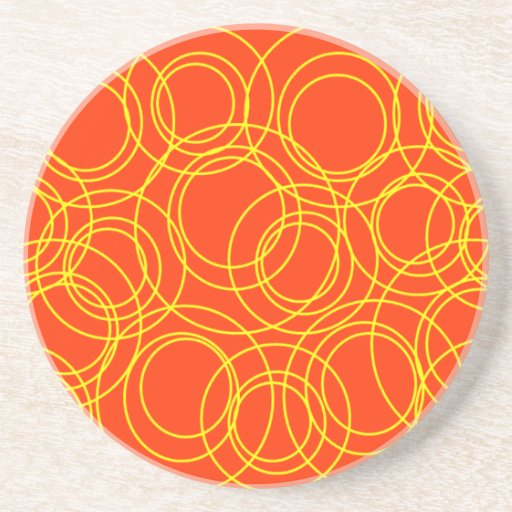 Círculos amarillos en el naranja posavasos de arenisca
