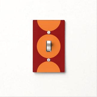 Círculos anaranjados en rojo cubierta para interruptor