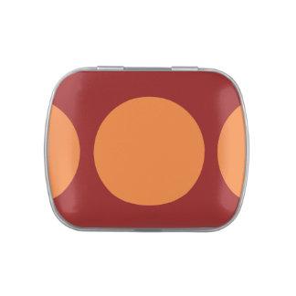 Círculos anaranjados en rojo latas de caramelos