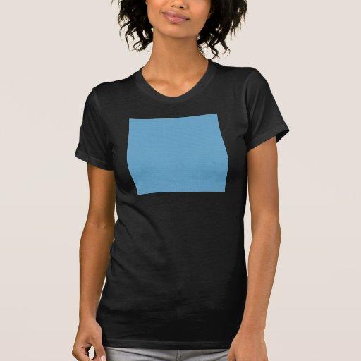 Círculos azules claros festivos en un backgro azul camiseta
