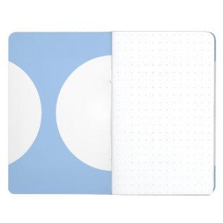 Círculos blancos en azul claro cuadernos grapados