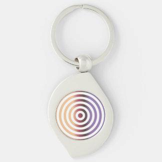 Círculos concéntricos coloridos llavero plateado en forma de espiral