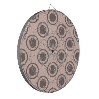 Círculos decorativos en el fondo de color salmón tabla dardos