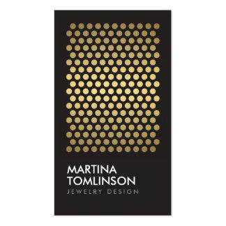 Círculos del oro en tarjeta de visita negra del