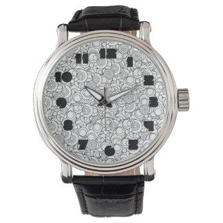 Círculos maravillosos blancos y negros relojes de pulsera