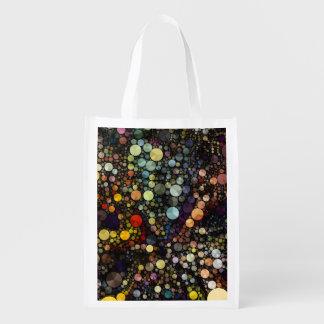 Círculos multicolores geométricos de los modelos bolsas reutilizables