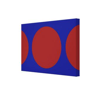 Círculos rojos en azul impresión en lienzo