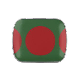 Círculos rojos en verde frascos de caramelos