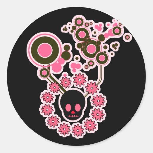 Círculos rosados del cráneo y de la flor pegatinas
