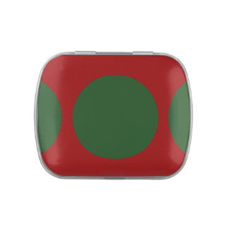 Círculos verdes en rojo latas de dulces