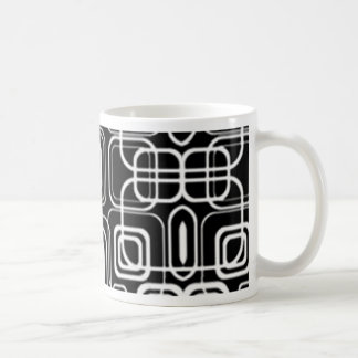 Círculos y cuadrados blancos en productos negros taza de café